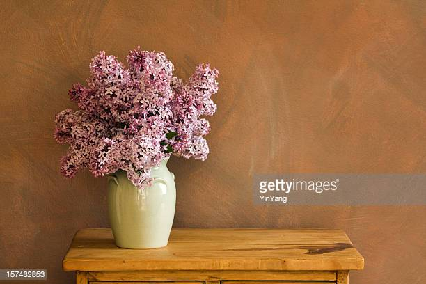 Purple Lilac Flowers, Spring Bouquet in Vase on Wooden Table