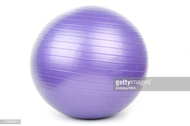 Purple Pilates ball set on a white background