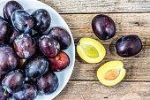 Purple plums, autumn fruits harvest