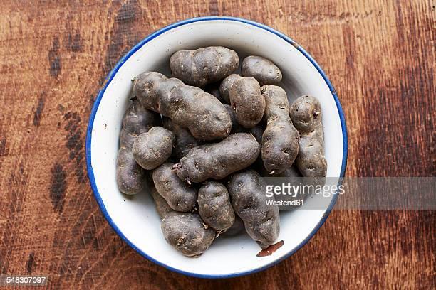 Purple potatoes in an enamel bowl