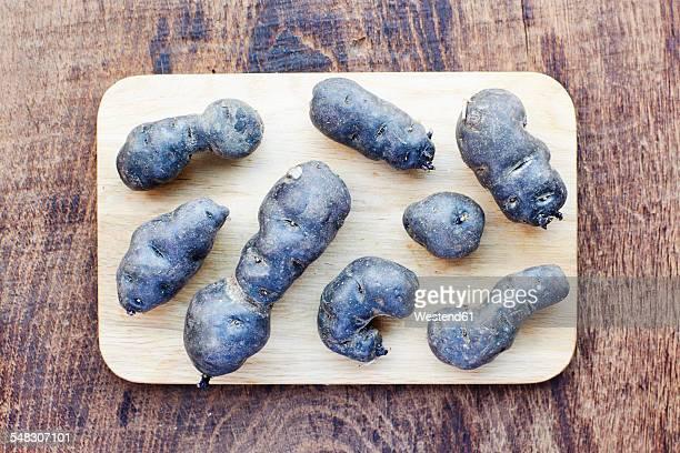 Purple potatoes on a cutting board