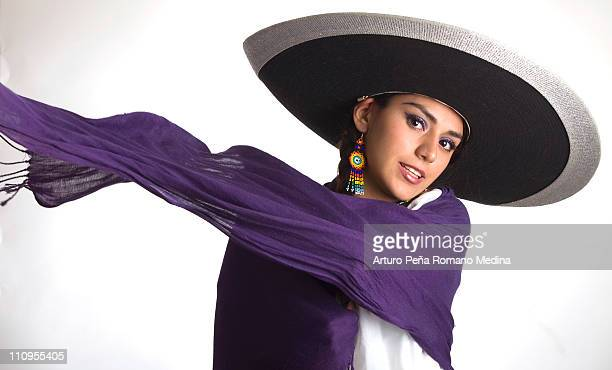 Purple scarf swirling in wind with white background