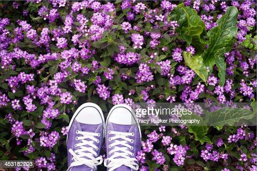 Purple shoes & purple flowers.