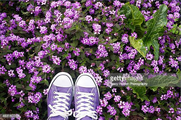 Purple shoes & purple flowers.
