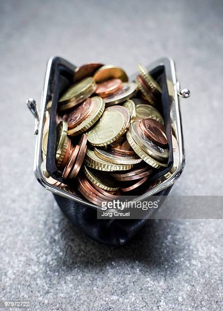 Purse filled with various Euro coins