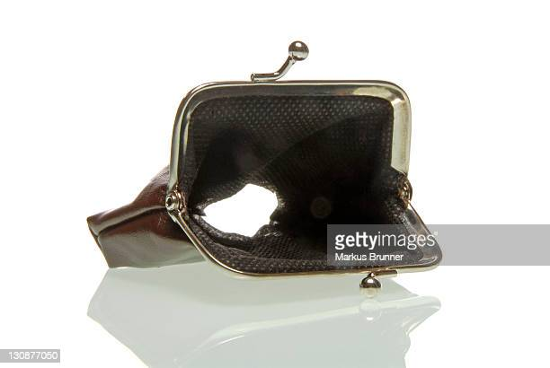 Purse with a hole, symbolic image for the economic crisis