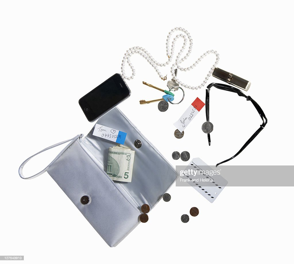 Purse with cell phone, money, jewelry : Stock Photo