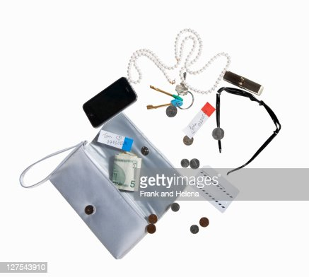 Purse with cell phone, money, jewelry : ストックフォト