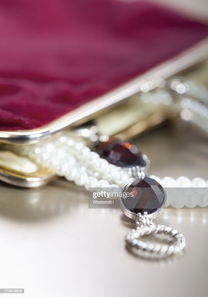 Purse with jewellery, close up