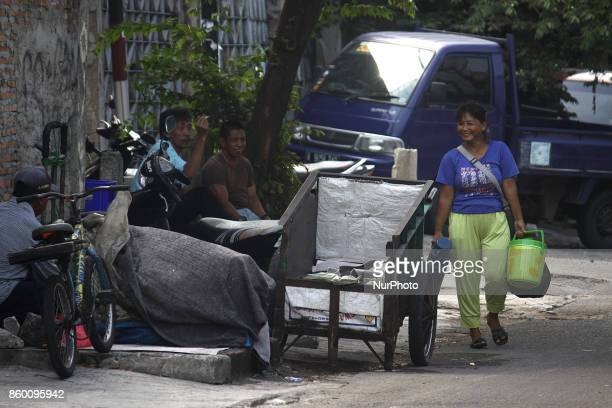 Purwati Monica's mother sells coffee near Pasar Senen Station Central Jakarta on October 11 2017 Monica is the 15yearold girl who invited by the UN...