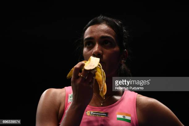 Pusarla V Sindhu of India eats banana as she compete against Beiwen Zhang of USA during Womens Single Round 2 match of the BCA Indonesia Open 2017 at...