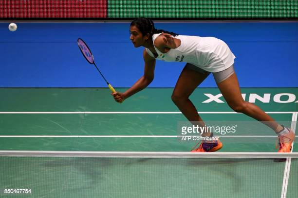 Pusarla V Sindhu of India hits a return against Nozomi Okuhara of Japan during their women's singles second round match at the Japan Open Badminton...