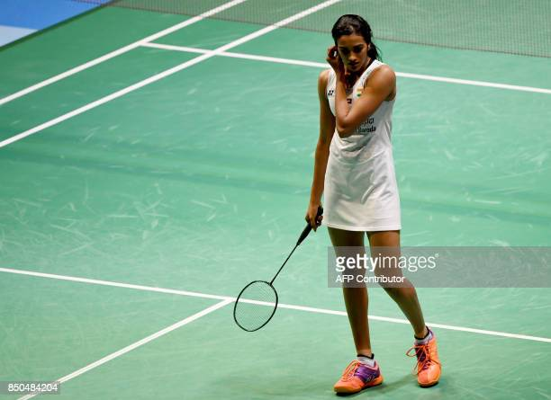 Pusarla V Sindhu of India reacts after losing a point against Nozomi Okuhara of Japan during their women's singles second round match at the Japan...