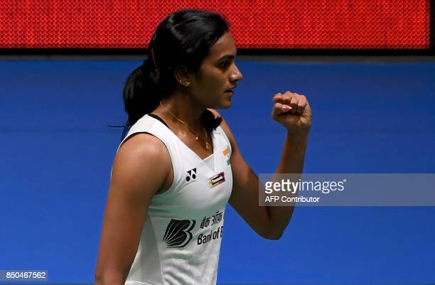 Pusarla V Sindhu of India reacts after winning a point against Nozomi Okuhara of Japan during their women's singles second round match at the Japan...