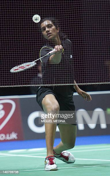 Pusarla Venkata Sindhu of India returns against Rena Wang of the US during their women's singles qualification match at the All England Open...