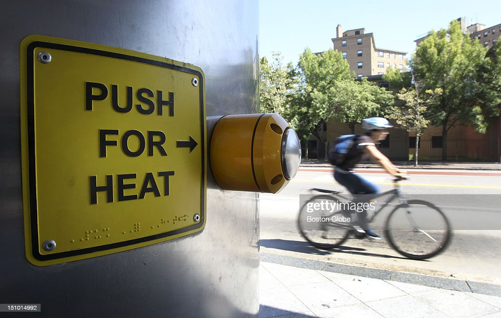 A 'Push for heat' button for overhead heaters is a reminder of colder temperatures to come at the Silver Line bus shelter on Washington Street in the South End of Boston, Mass., Aug. 27, 2012.