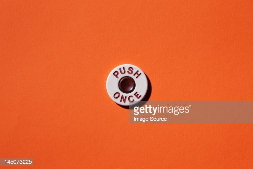 Push once'' button on orange background