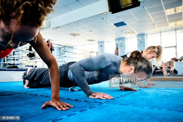 Push up in fitness class at the health club