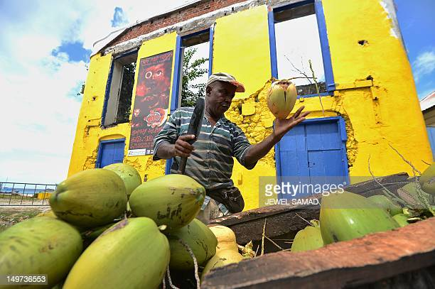 A pushcartcoconutvendor cuts a coconut for a customer in Bridgetown on April 12 2012 Historically the economy of Barbados had been dependent on...