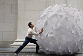 Pushing big ball of paper