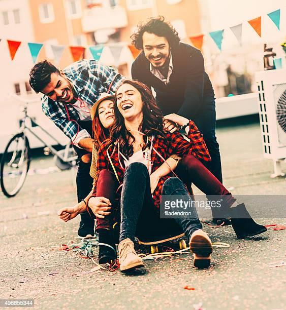 Pushing friends on skateboard