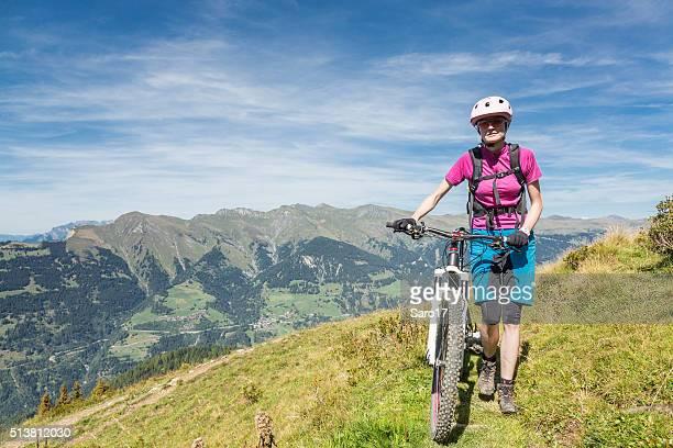 Pushing the bike at Graubünden mountains, Switzerland