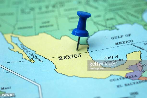 A pushpin marking Mexico as a travel destination on a map