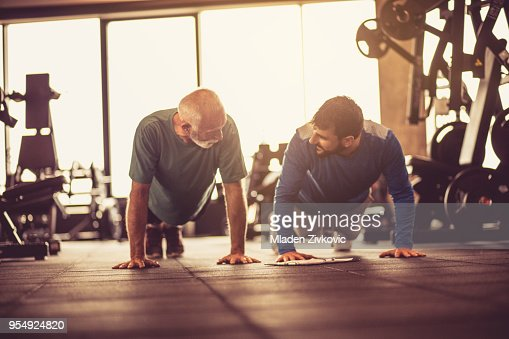 Push-ups at gym. : Stock Photo