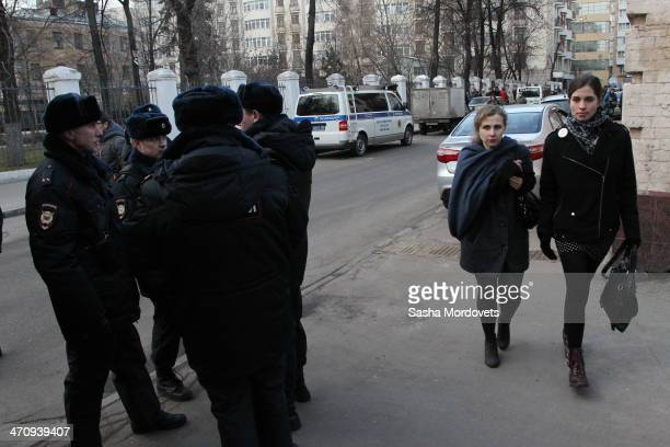 Pussy Riot punk group member Nadezhda Tolokonnikova and Maria Alekhina walk past police as they arrive outside of Zamoskvoretsky District Court...
