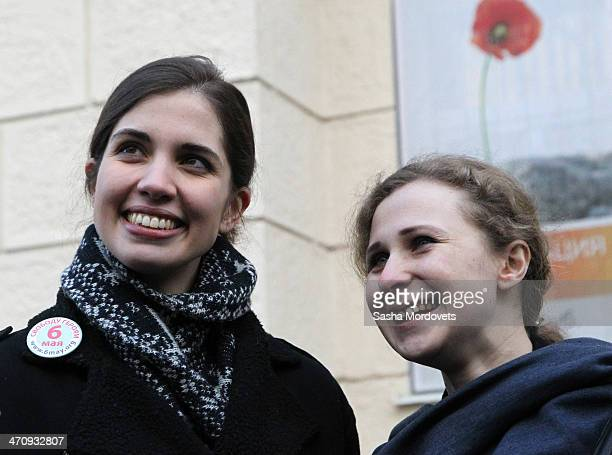 Pussy Riot punk group members Nadezhda Tolokonnikova and Maria Alekhina stand outside of Zamoskvoretsky District Court during an unsanctioned protest...