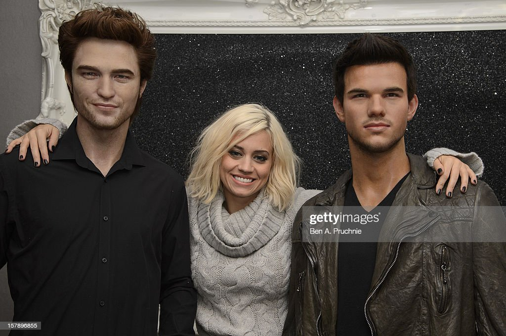 Pussycat Doll Kimberly Wyatt poses nexct to wax figures of Robert Pattinson and Taylor Lautner at Madame Tussauds on December 7, 2012 in London, England.