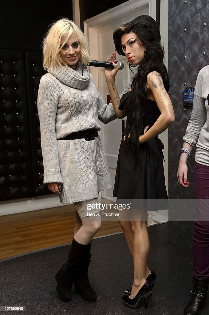 Pussycat Doll <a gi-track='captionPersonalityLinkClicked' href=/galleries/search?phrase=Kimberly+Wyatt&family=editorial&specificpeople=678958 ng-click='$event.stopPropagation()'>Kimberly Wyatt</a> poses next to a wax figure of Amy Winehouse at Madame Tussauds on December 7, 2012 in London, England.