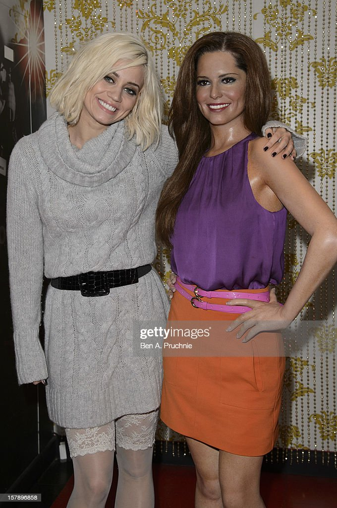 Pussycat Doll Kimberly Wyatt poses next to a wax figure of Cheryl Cole at Madame Tussauds on December 7, 2012 in London, England.
