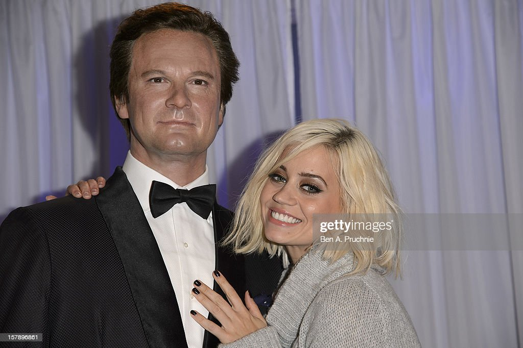 Pussycat Doll Kimberly Wyatt poses next to a wax figure of Colin Firth at Madame Tussauds on December 7, 2012 in London, England.
