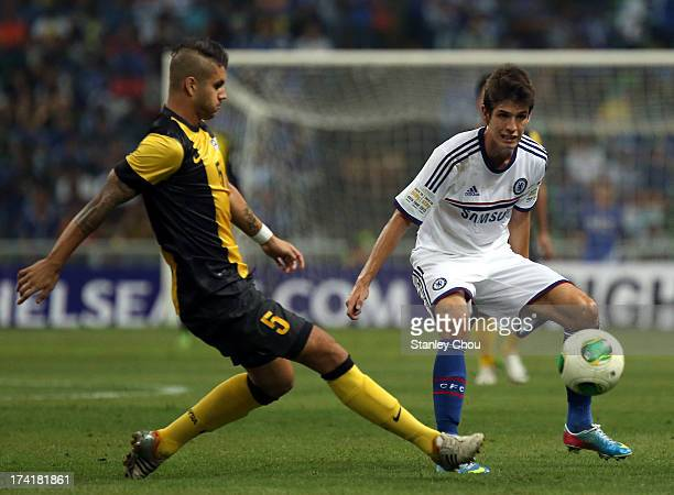 Putra Nadher of Malaysia passes the ball past Lucas Piazon of Chelsea during the match between Chelsea and Malaysia XI on July 21 2013 at the Shah...