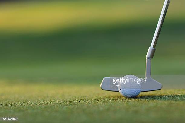 Putter Next to Golf Ball