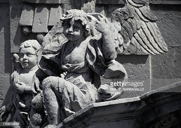 Putti decorative detail from the facade of St Sebastian's Basilica Acireale Sicily Italy