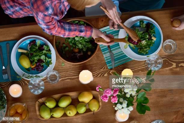 Putting fresh salad