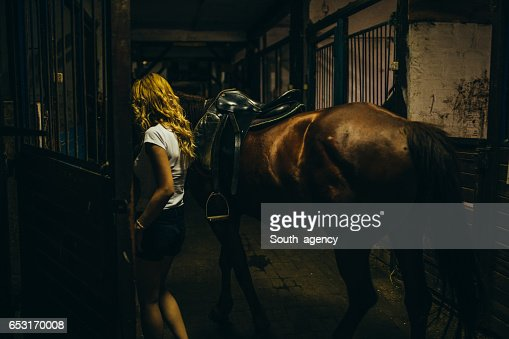 Putting horse in a stable : Stock Photo