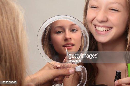 putting on makeup : Stock Photo
