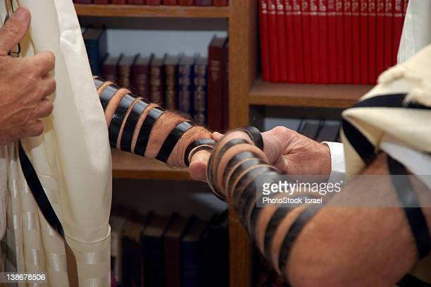 Putting on tefillin