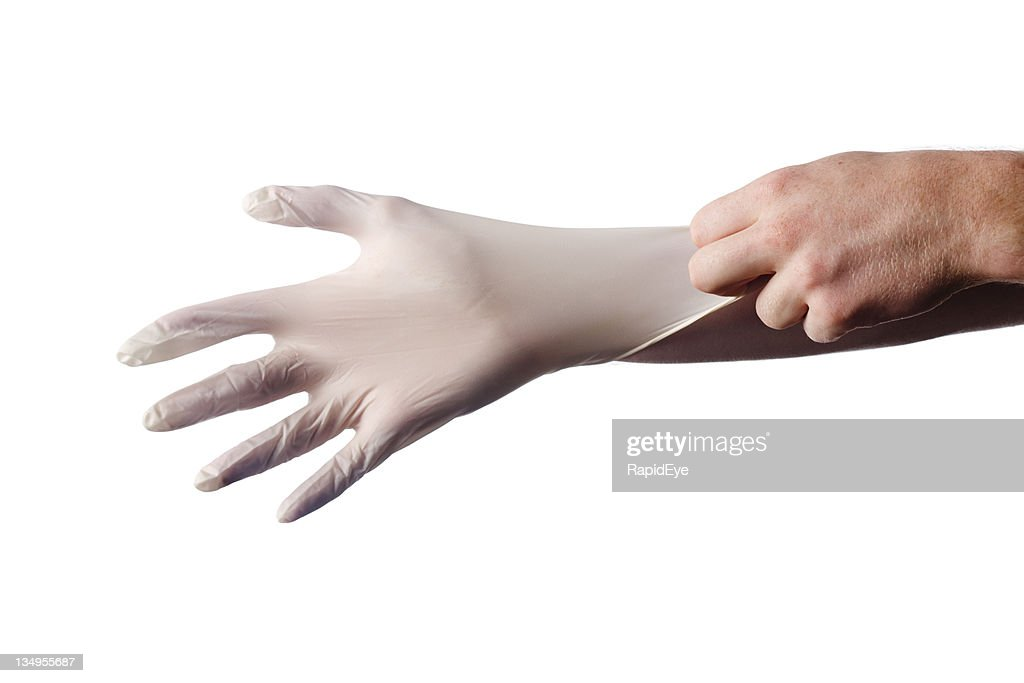 Putting surgical glove on : Stock Photo
