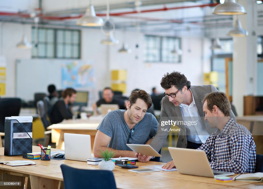 Putting their heads together for an awesome design : Stock Photo