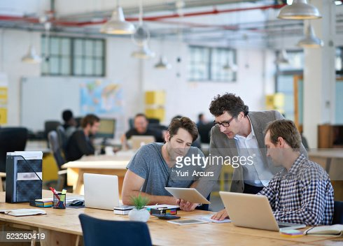 Putting their heads together for an awesome design : Stockfoto
