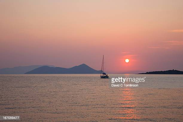 Putting to sea at sunrise, Frikes, Ithaca, Greece