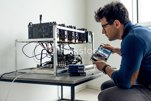 Putting together crypto currency machine : Stock Photo