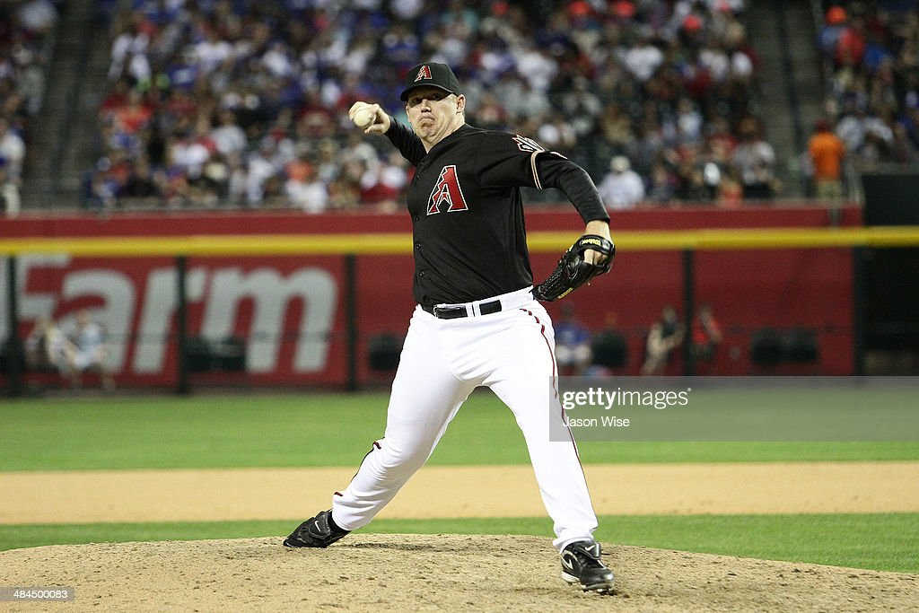 <a gi-track='captionPersonalityLinkClicked' href=/galleries/search?phrase=J.J.+Putz&family=editorial&specificpeople=243125 ng-click='$event.stopPropagation()'>J.J. Putz</a> #40 of the Arizona Diamondbacks delivers a pitch against the Los Angeles Dodgers at Chase Field on April 12, 2014 in Phoenix, Arizona.