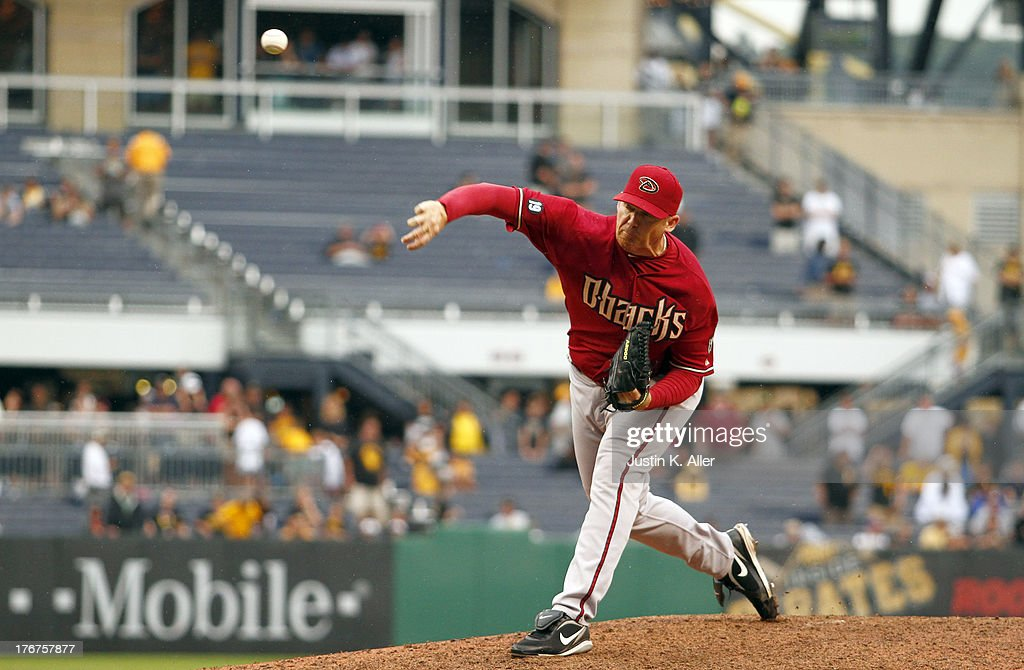 <a gi-track='captionPersonalityLinkClicked' href=/galleries/search?phrase=J.J.+Putz&family=editorial&specificpeople=243125 ng-click='$event.stopPropagation()'>J.J. Putz</a> #40 of the Arizona Diamondbacks pitches in the sixteenth inning against the Pittsburgh Pirates during the game on August 18, 2013 at PNC Park in Pittsburgh, Pennsylvania.