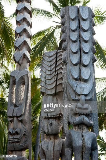 Pu'uhonua O Honaunau National Historic Park Hale O Keawe reconstructed temple with wood carvings South Kona Coast Big Island Ki'i totem images wood...