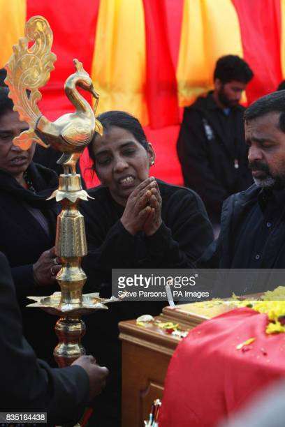 Puwaneswary and Kanapathy Varnakulasingham the mother and father of Murugathasan Varnakulasingham 26 from London stand by their son's coffin during...